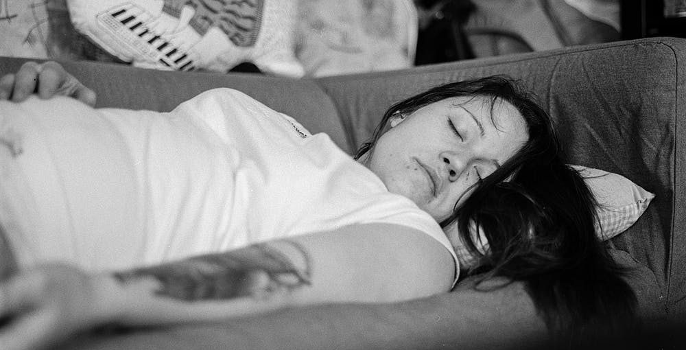 black and white image of woman getting better sleep