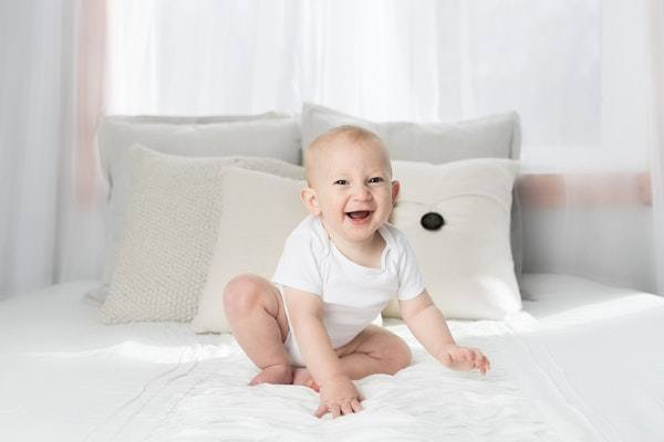 Baby is very happy while seating at the best ikea mattresses